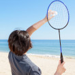 The girl on the beach serves playing badminton. Close-up. — Stock Photo