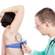 Dermatologist Doctor with stethoscope looks around the patient f — Stock Photo