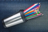 Group of colored pencils in cup with metal. On the jeans texture — Stock Photo