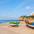 The beach at the village of Carvoeiro with fishing boats in the — Foto de Stock
