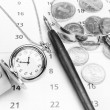 Black and white image bank concept. Money Magnifier calendar. — Stock Photo