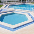 Pentagonal summer pool outside. For a vacation getaway. — Stock Photo