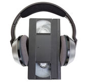 An old classic videotape VHS and wireless headphones. — Stock Photo