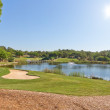 Stock Photo: Sports Park for a game of golf. With the lake and fountain.