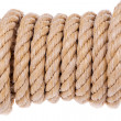 Coil of rope twisted into a roll. On a white background. — Stock Photo