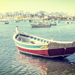 Vintage Card, fishing boat in the bay of the village of Ferragudo. Portugal. — Stock Photo