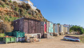Old fishing huts on the beach in the village of Ferragudo. — Stock Photo