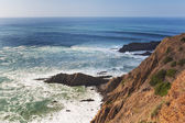 View of the seascape on top of the rocks and waves. Portugal. — Foto de Stock