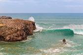 Landscape sea fishermen on rocks fish in the ocean. Portugal. — Stock Photo