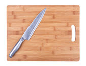 Kitchen cutting board and a large kitchen knife. Close-up. — ストック写真