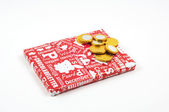 Present and chocolate coins — Stock Photo