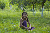 Cute little girl having fun outdoors and laughing — Stock Photo