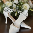 Royalty-Free Stock Photo: Bride\'s shoes and flowers