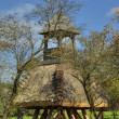 Stock Photo: Wooden bell tower wit thatch