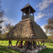 Wooden bell tower wit thatch — Stock Photo