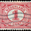 Stock Photo: NETHERLANDS - CIRC1898: Netherlands Stamp Numeral 1 Cent, circ