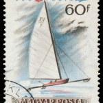Постер, плакат: HUNGARY CIRCA 1955: mail stamp printed in Hungary featuring wi