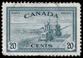 CANADA - CIRCA 1946: a stamp printed in the Canada shows Combine — Stock Photo