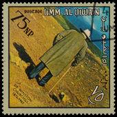 Umm al qiwain - por volta de 1966: um selo impresso em uaq dedicado winst — Fotografia Stock
