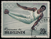 BURUNDI - CIRCA 1964: A stamp printed in Burundi shows Vaulting, — Stock Photo