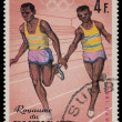 BURUNDI - CIRCA 1964: A stamp printed in Burundi shows relay rac — Stock Photo