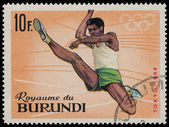 BURUNDI - CIRCA 1964: A stamp printed in Burundi shows Broad jum — Stock Photo