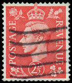 Stamp printed in UK shows image of the George VI — Stock Photo