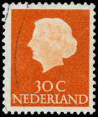 Stamp printed in Netherlands shows portrait of Queen Juliana — Stock Photo