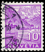 Stamp printed in Switzerland, shows Chillon Castle and Dents du — Stock Photo