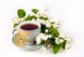 A cup of coffee with flowers — Stock Photo