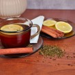 Mug of tea with lemon and cinnamon stick — Stock Photo