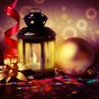 Magic lantern and Christmas decorations on abstract background — Stock Photo