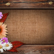 Beautiful autumn background with wooden frame and flowers on can — Stock Photo