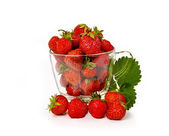 Fresh strawberries in a glass mug isolated on white background — Stock Photo