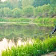 Fisherman Casting on Calm River — Stock Photo #18977763