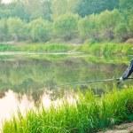 Fisherman Casting on Calm River — Stock Photo