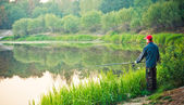 Fisherman Casting on Calm River — Stock Photo