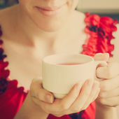 Hands holding a cup — Stock Photo