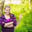 A Beautiful Young Girl Standing On A Forest Path Road — Stock Photo #22250395