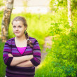 A Beautiful Young Girl Standing On A Forest Path Road — Stock Photo #22515209