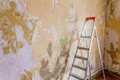 Old wallpapers and ladder — Stock Photo
