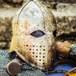 Protective helmet with a visor on medieval knight — Stock Photo