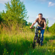 Young Man On The Bicycle — Stock Photo