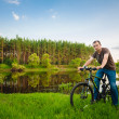 Stockfoto: Young mon GT bicycle biking through sunny countryside.
