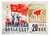 "Postcard printed in the USSR shows the political slogan ""Workers — Stock Photo"