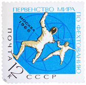 Stamp printed in the USSR (Russia) shows two fencers with inscri — Stock Photo