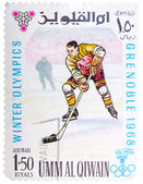 Stamp printed by Umm al-Quwain, shows hockey player bats the puc — Stock Photo