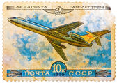Stamp printed in USSR shows the Aeroflot Emblem and aircraft wit — Stock Photo