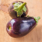 Eggplants On A Wooden Background — Stock Photo