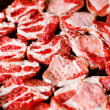Fresh raw meat in a frying pan — Stock Photo